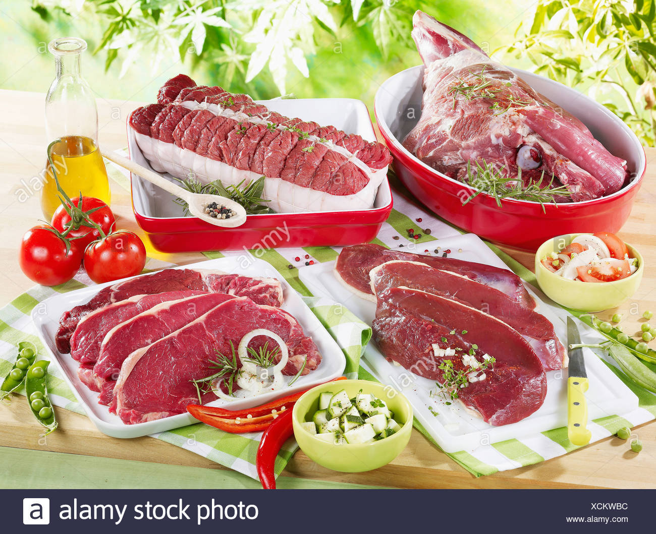 Raw leg of lamb,duck, faux filets,roast beef.. - Stock Image