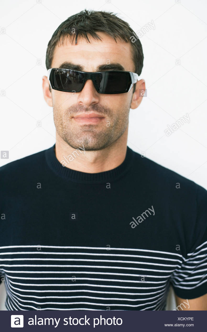 fd3ecd936115 Close-up of a mid adult man wearing sunglasses Stock Photo ...