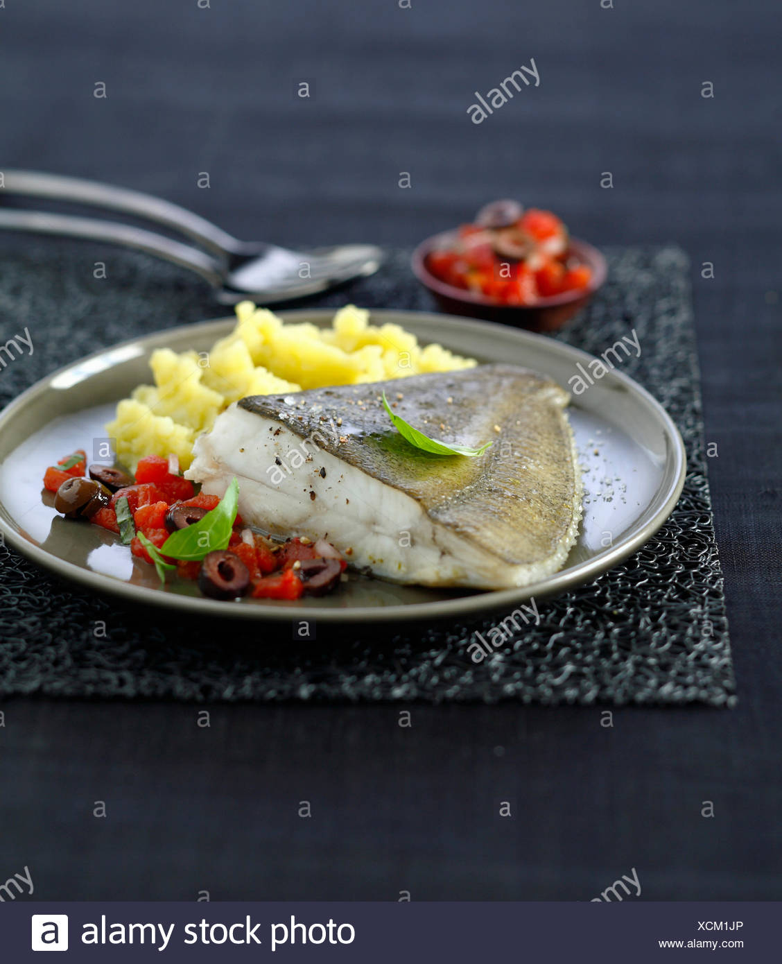 Pan-fried turbot in virgin sauce,mashed potatoes with olive oil - Stock Image