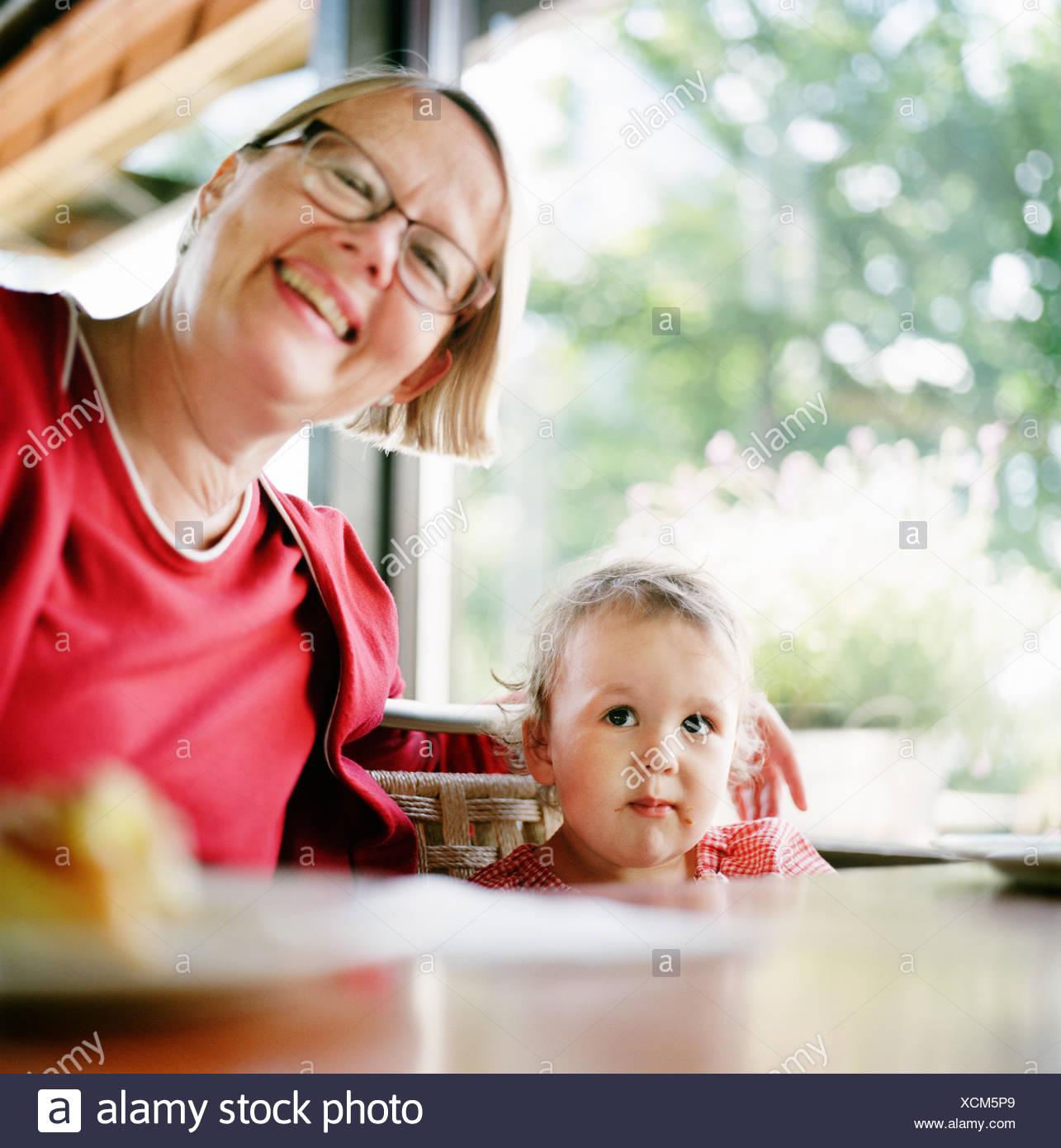 Finland, Helsinki, Uusimaa, Portrait of grandmother with granddaughter (2-3) - Stock Image
