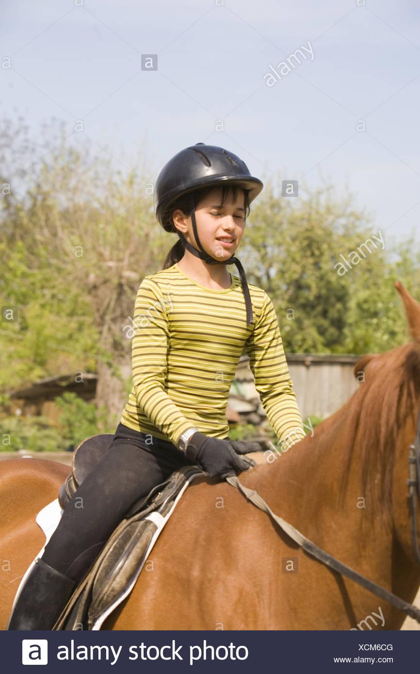 girl an a horse - Stock Image