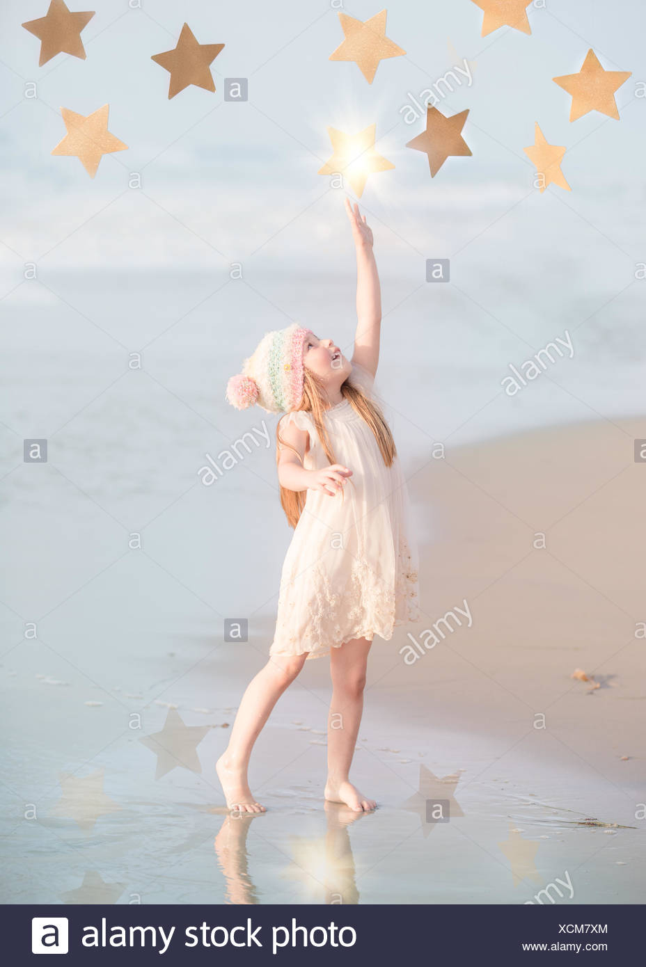 Girl reaching for the stars - Stock Image