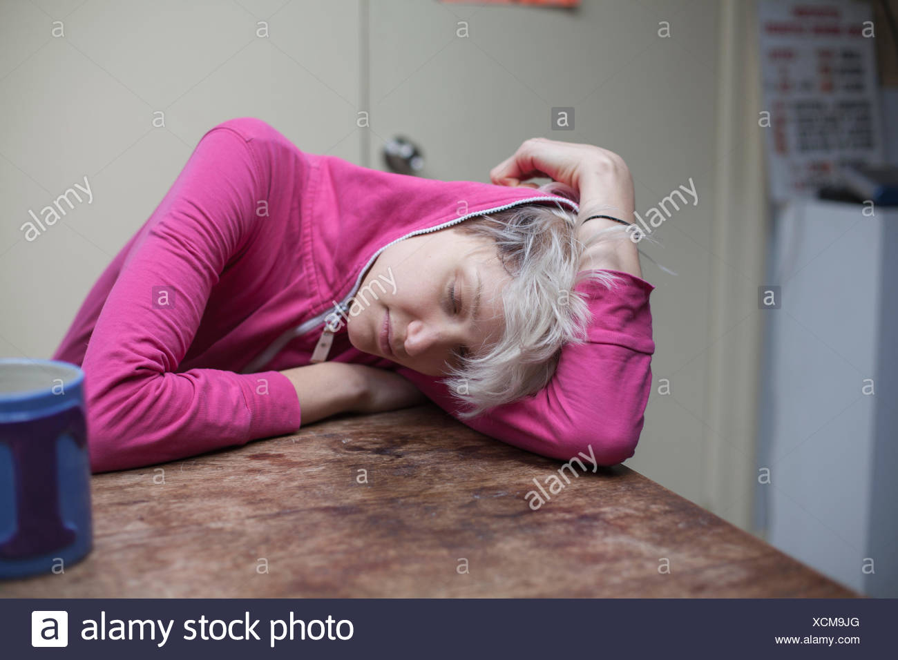 Young woman hanging out in her apartment - Stock Image