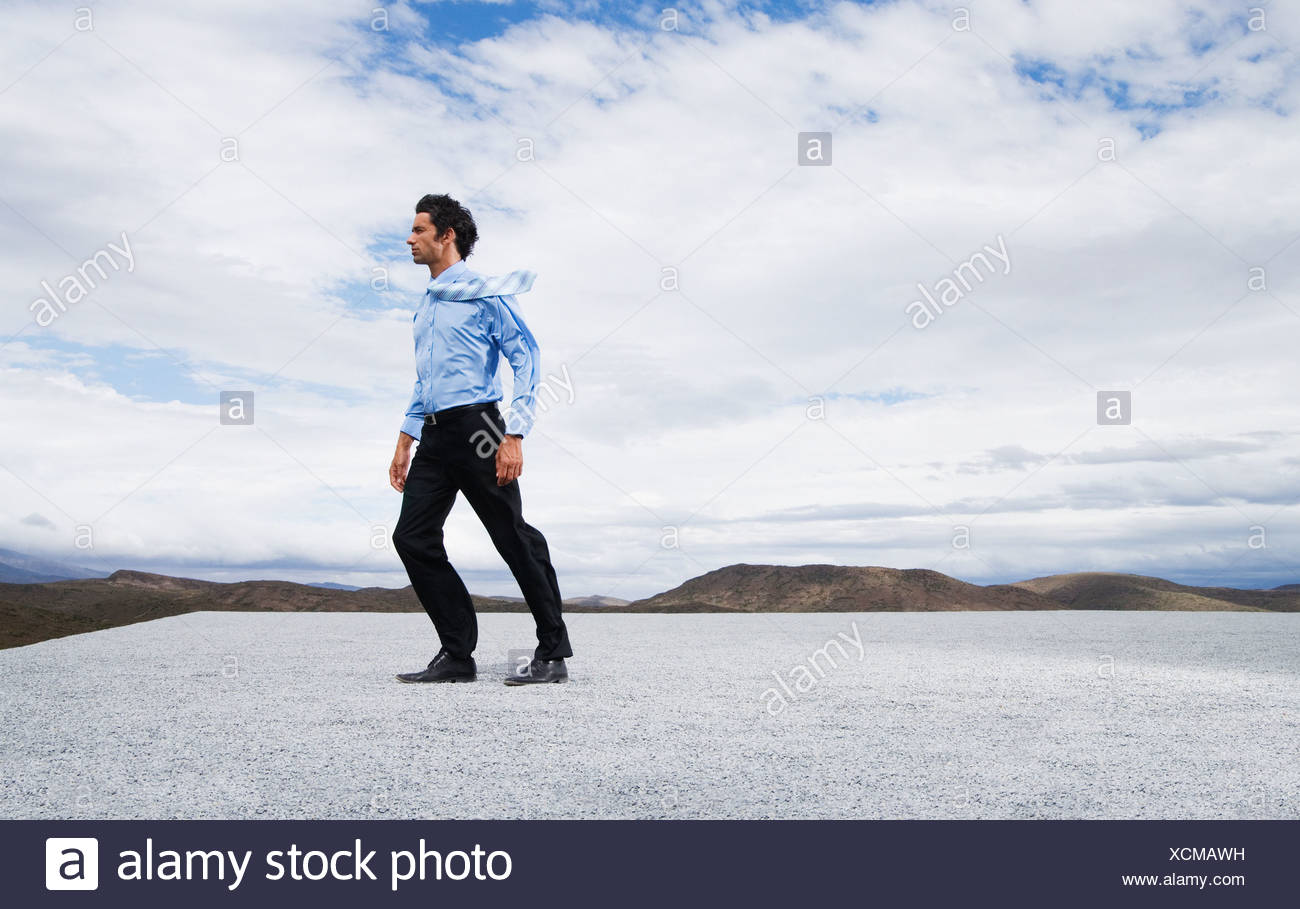 Man leaning into the wind - Stock Image