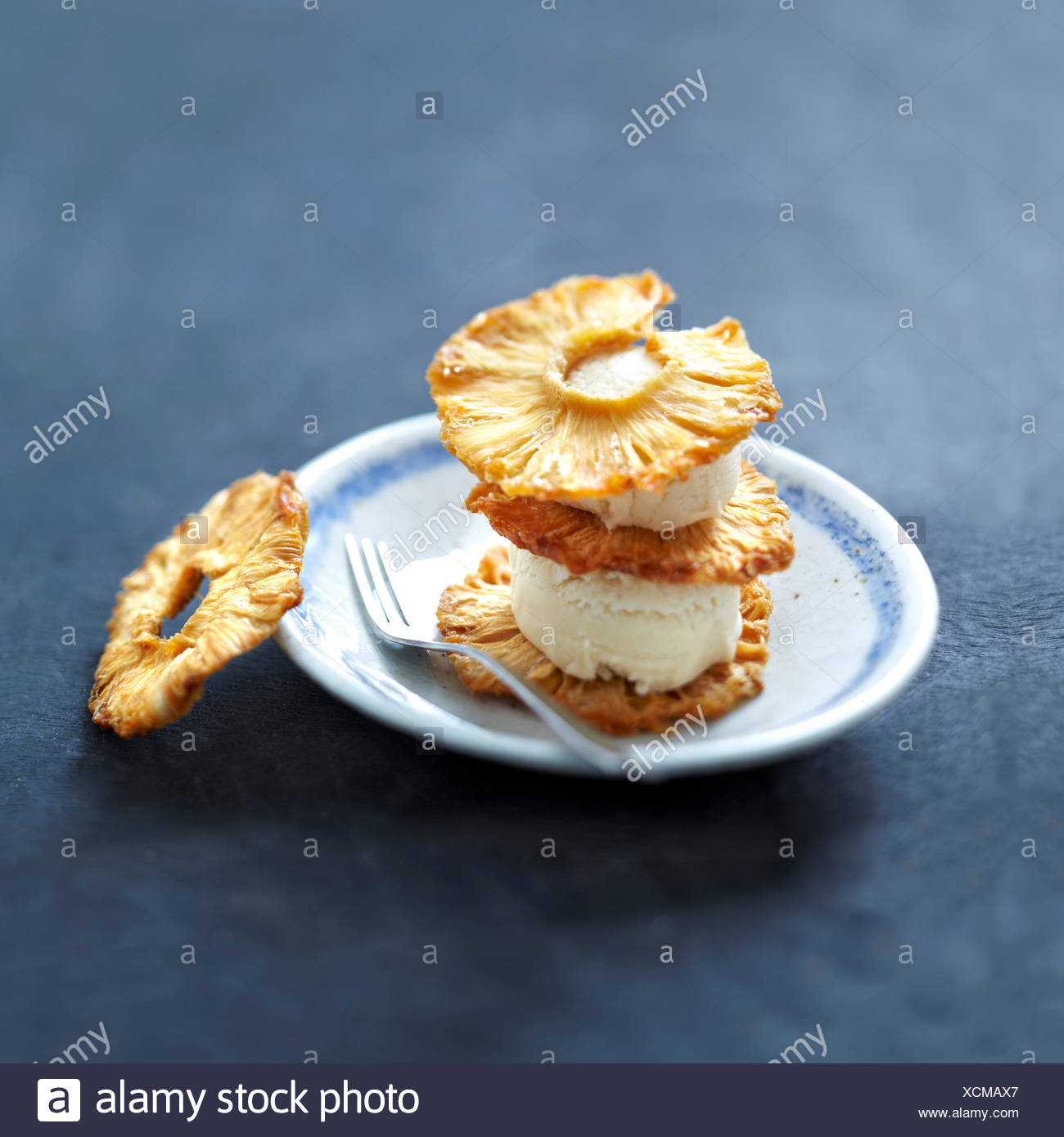 Sliced fried pineapple and coconut ice cream dessert - Stock Image