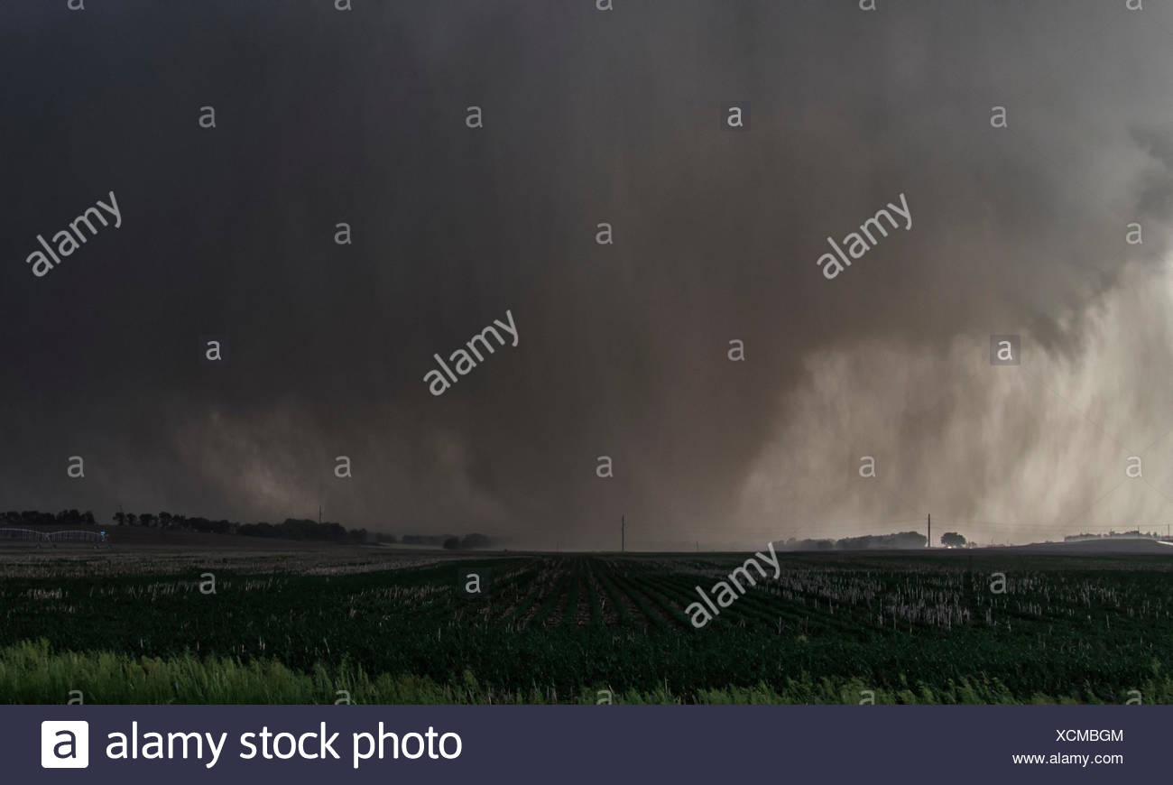A violent, rain-wrapped wedge tornado rips up farmland in rural Kansas - Stock Image