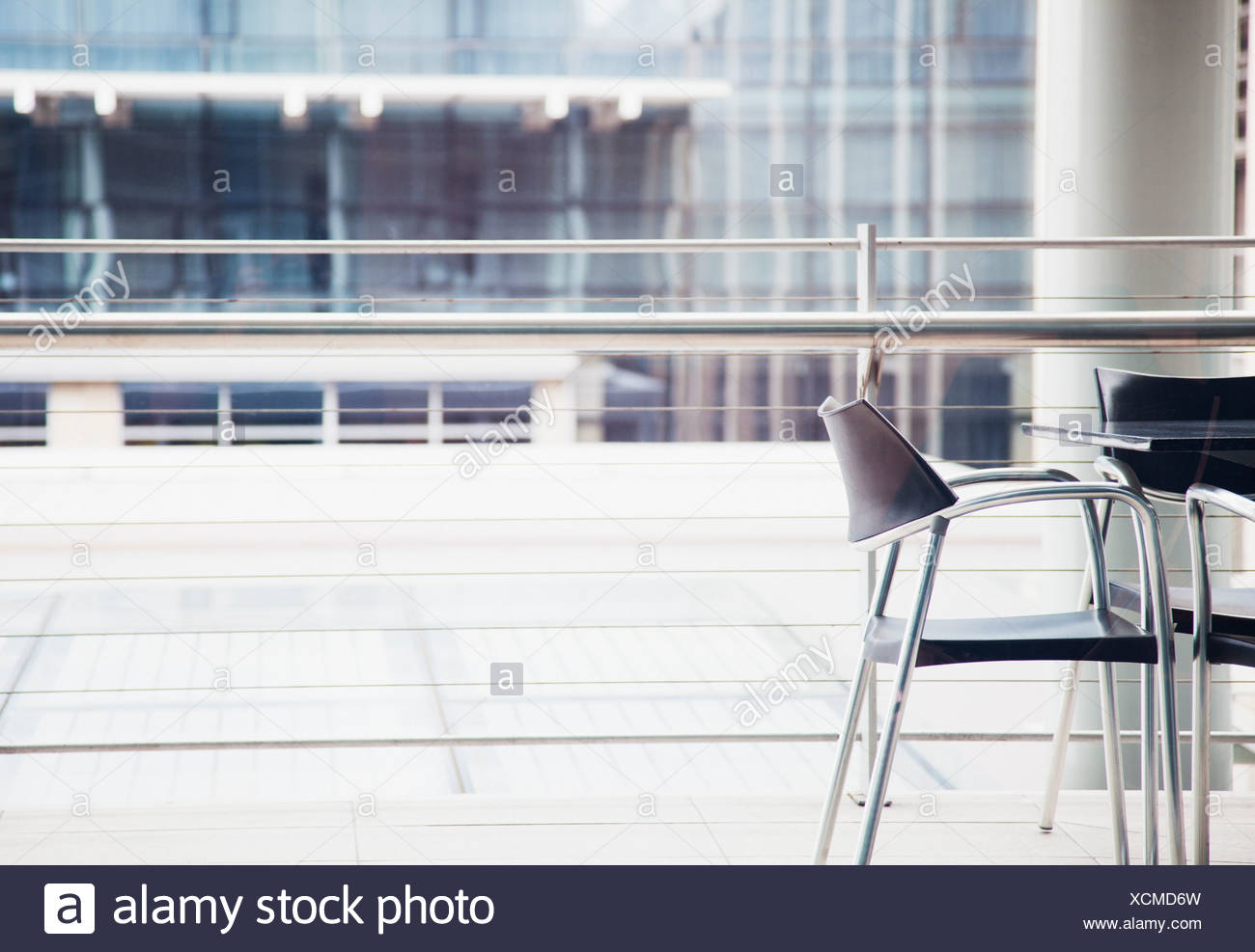 Chairs and table near window - Stock Image