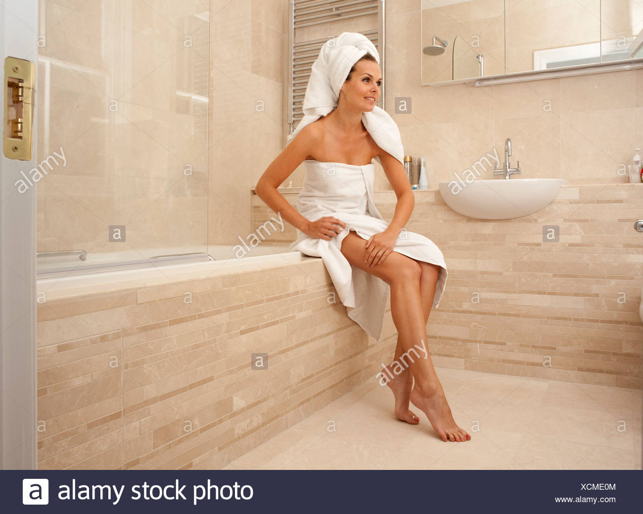 Beautiful woman looking after her body - Stock Image