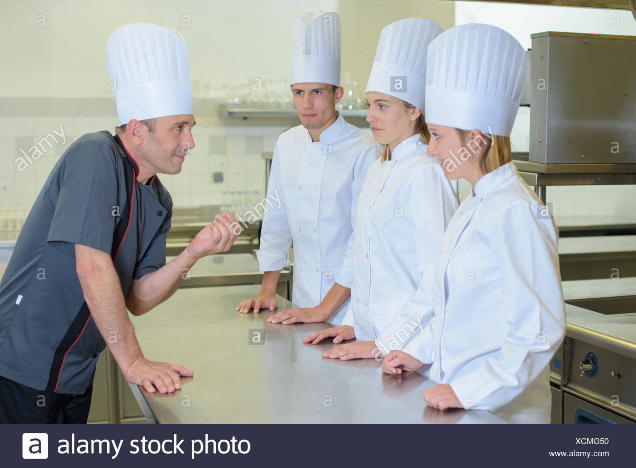 giving a lecture in the kitchen - Stock Image