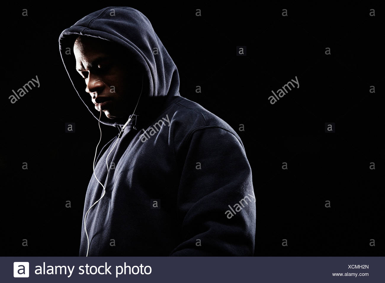 Mid adult man wearing hooded top - Stock Image
