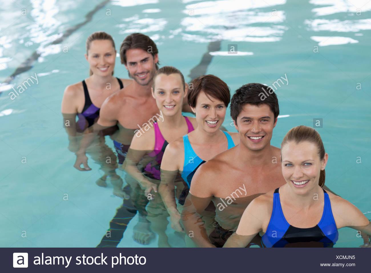 Six people in swimming pool - Stock Image