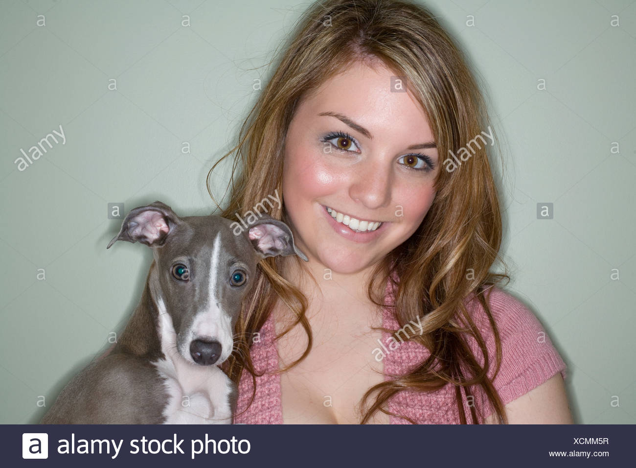 Portrait of young woman with Italian greyhound dog - Stock Image