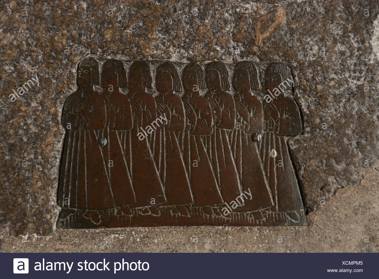 England, Cotswolds, Northleach, Church of St. Peter and St. Paul, brass figures on stone tomb - Stock Image