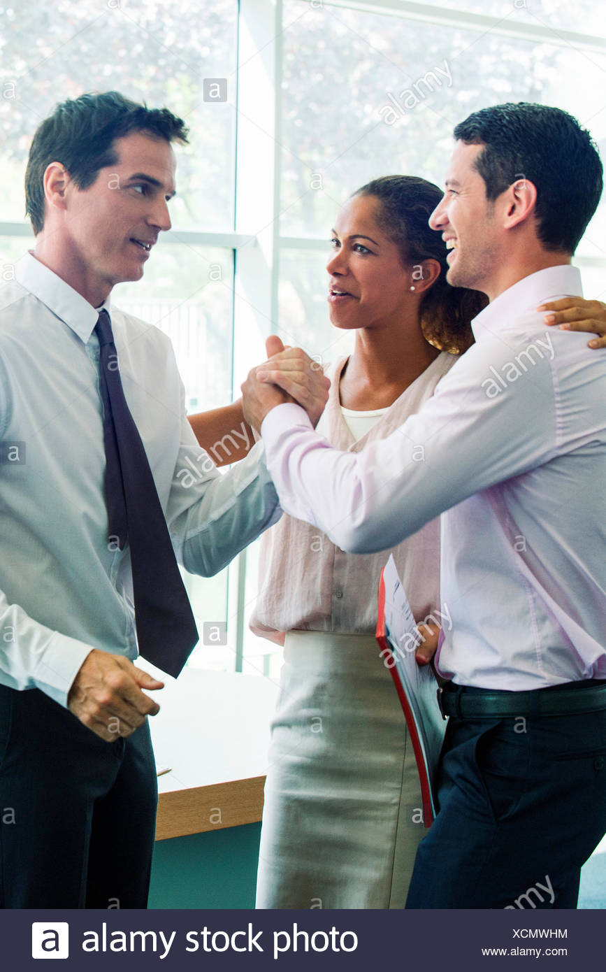 Businessmen congratulating each other - Stock Image