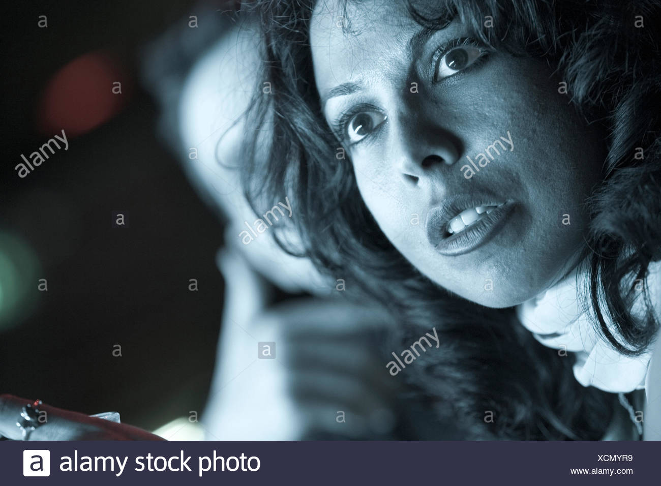 Portrait of a woman with a shocked look on her face. - Stock Image