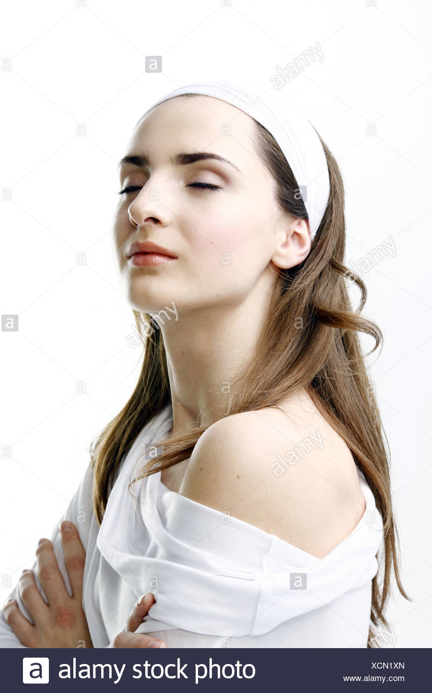 Portrait of a Pretty Young Woman in White - Stock Image