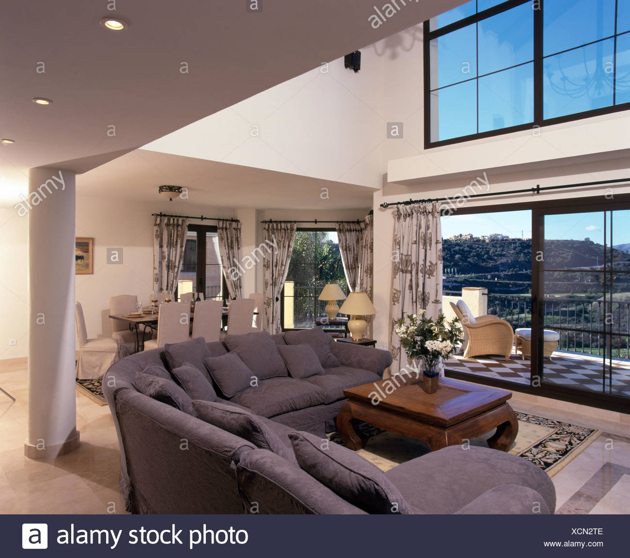 Grey L Shaped Sofa In Modern Double Height Spanish Living Room With