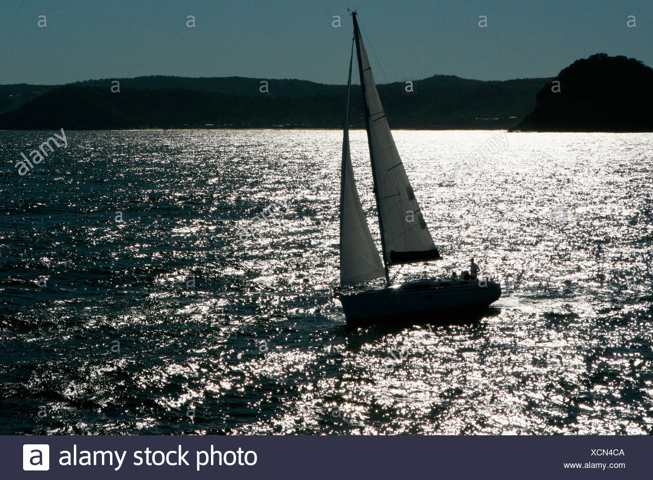 Aerial view of a sailing yacht cruising in Pittwater on the North Shore from Sydney, Australia. - Stock Image