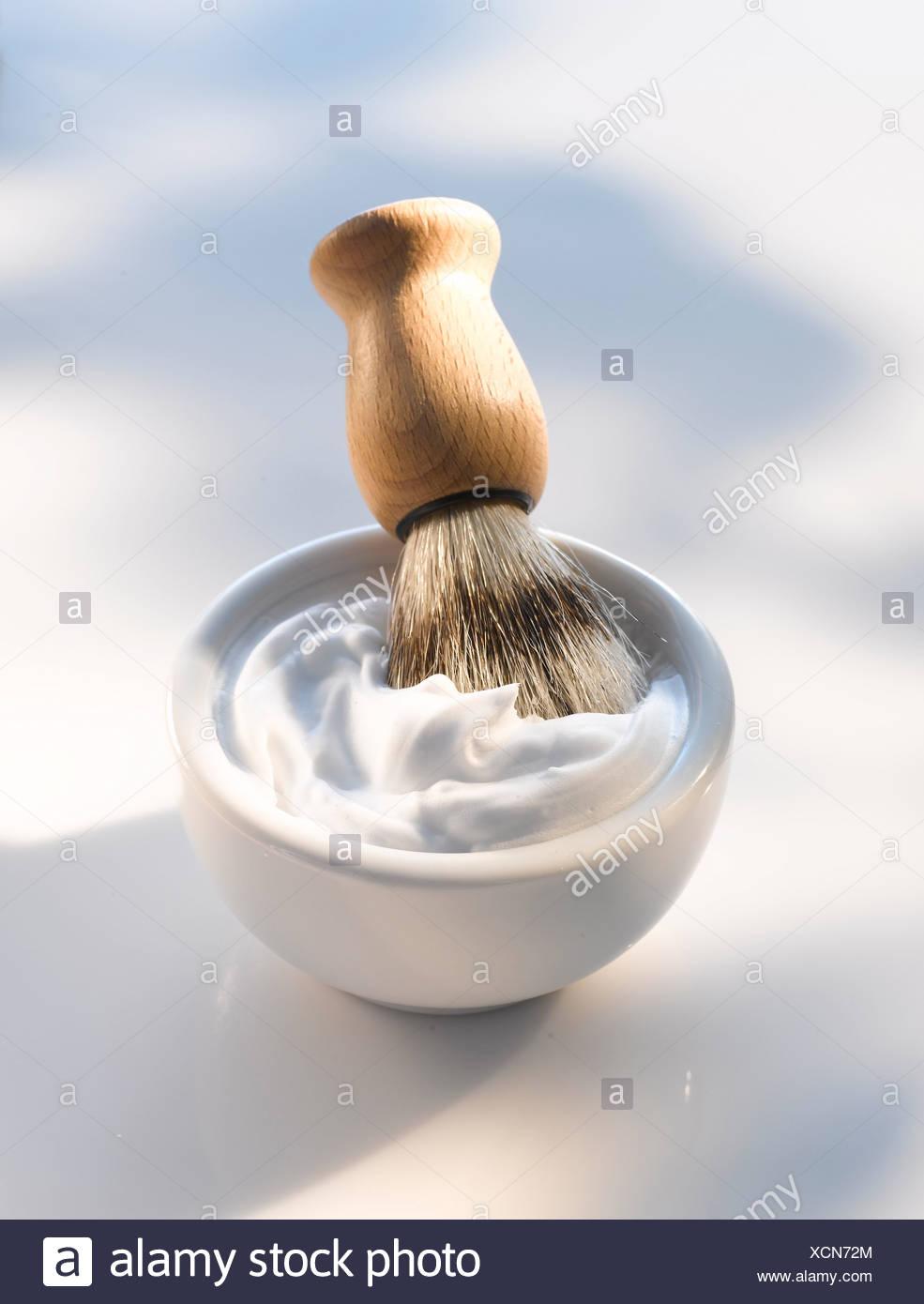 Shaving brush, shaving foam, close up - Stock Image