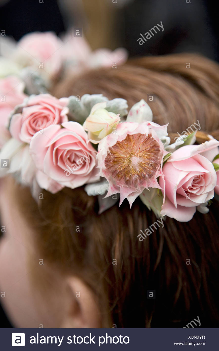 Rear view detail of a girl wearing a floral wreath Stock Photo