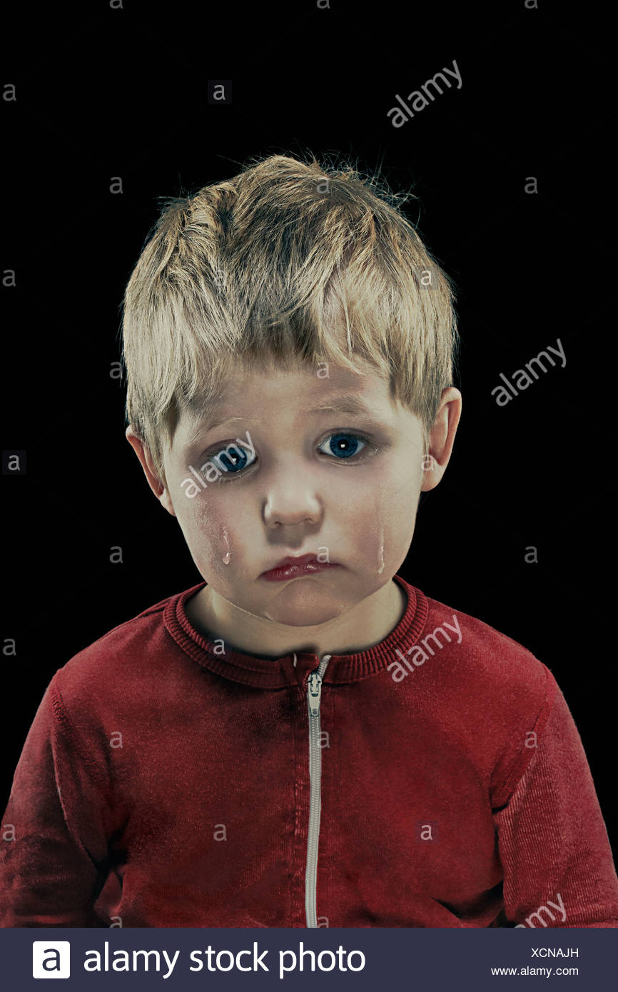Close up of boy's crying face - Stock Image