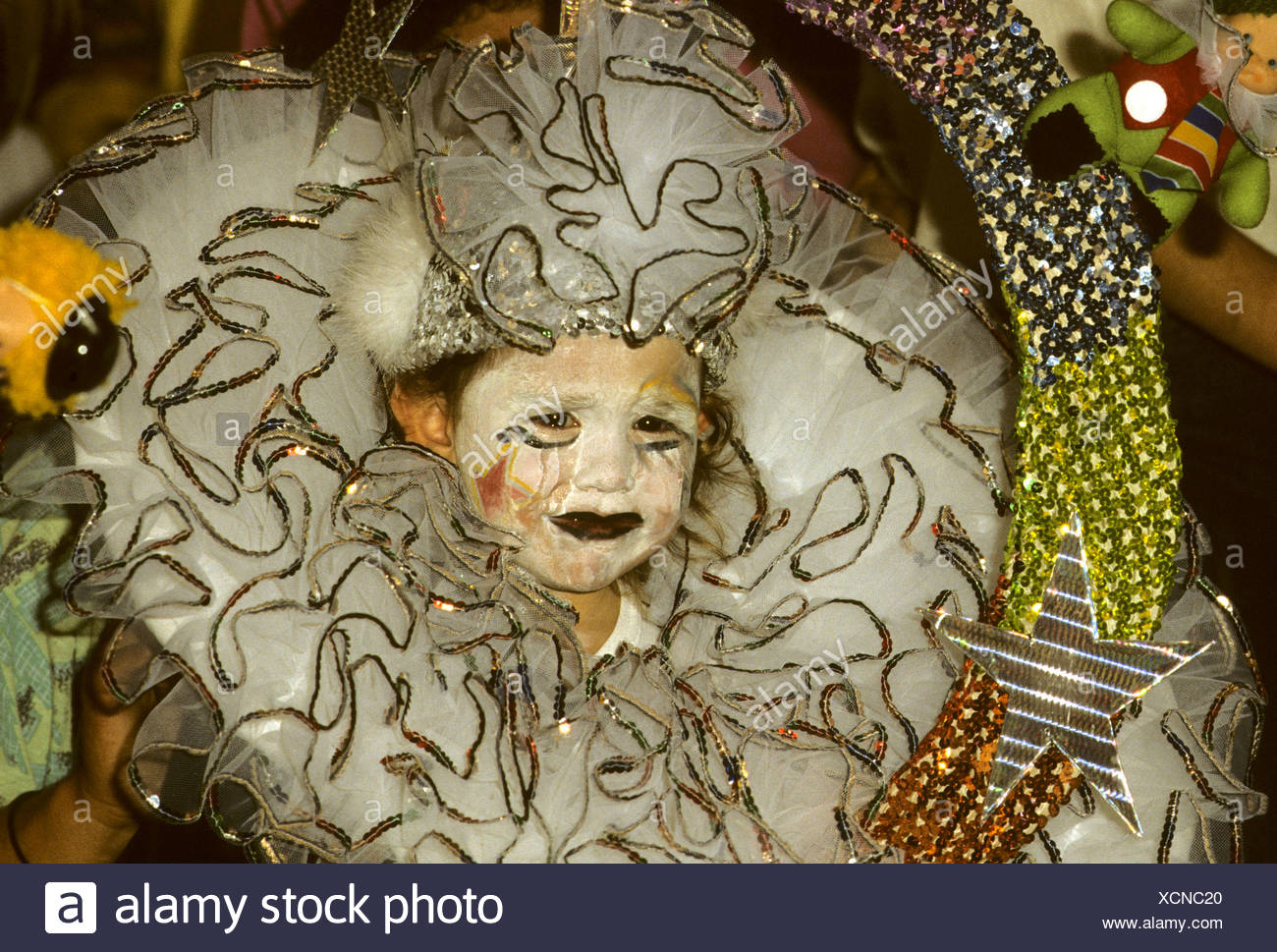 Child queen, crying with make-up smeared by tears during Carnival in Santa Cruz on Tenerife Island, Canary Islands, Spain - Stock Image