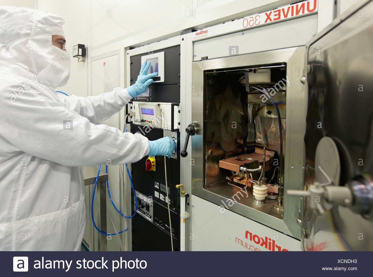 Layer deposition by using e-beam evaporator, clean room, thermal and e-beam evaporator, CIC nanoGUNE, Nanoscience Cooperative - Stock Image