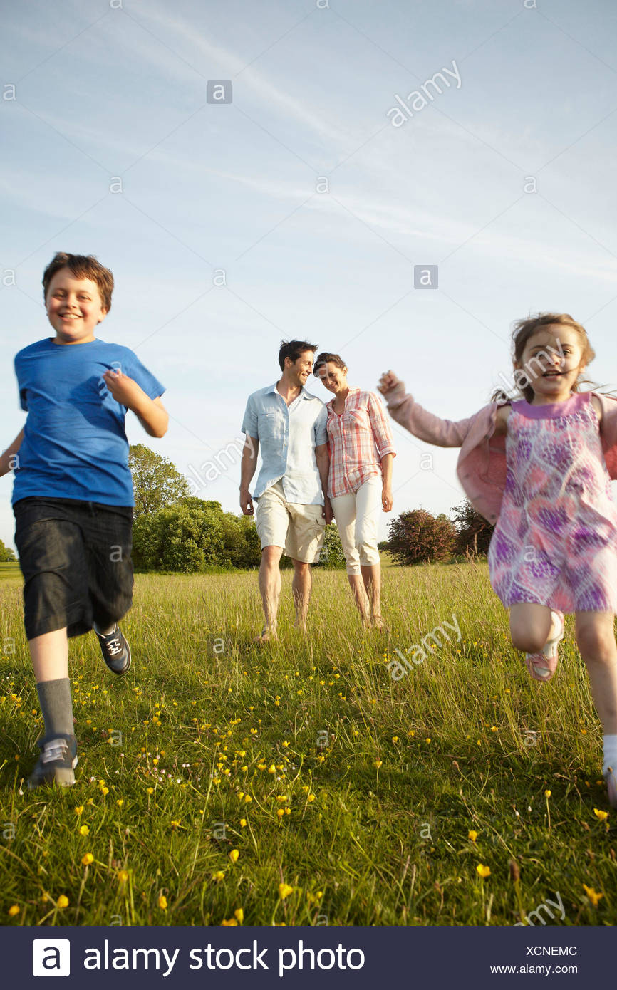 A family, two parents and two children outdoors in the summer. Stock Photo