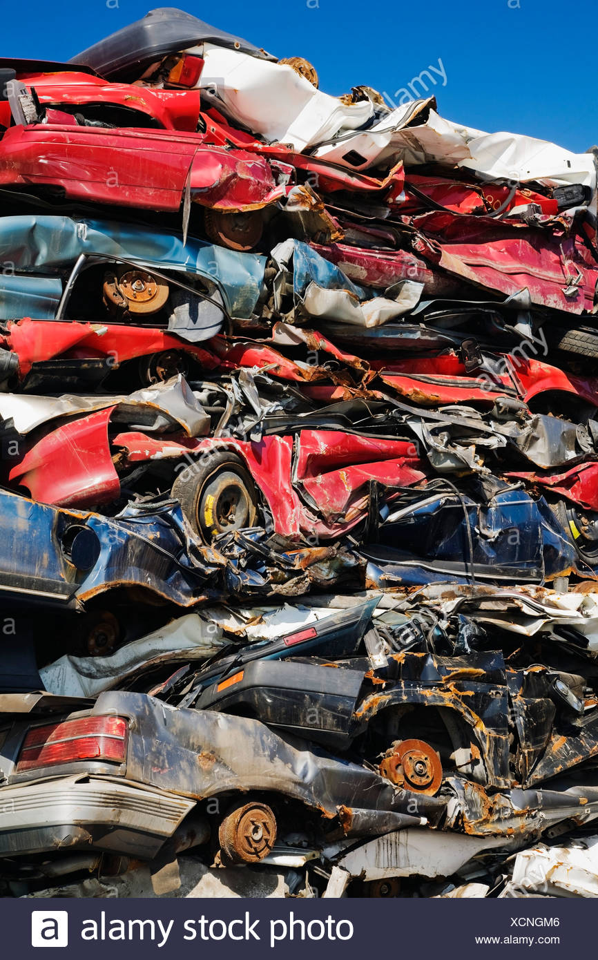 Quebec, Canada; Stacked And Crushed Automobiles At A Scrap Metal Recycling Junkyard - Stock Image