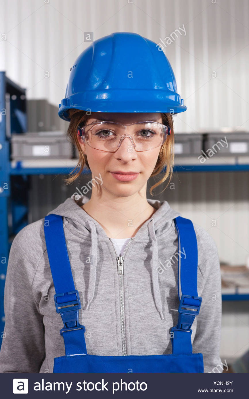 germany neukirch young woman wearing hardhat and safety glasses
