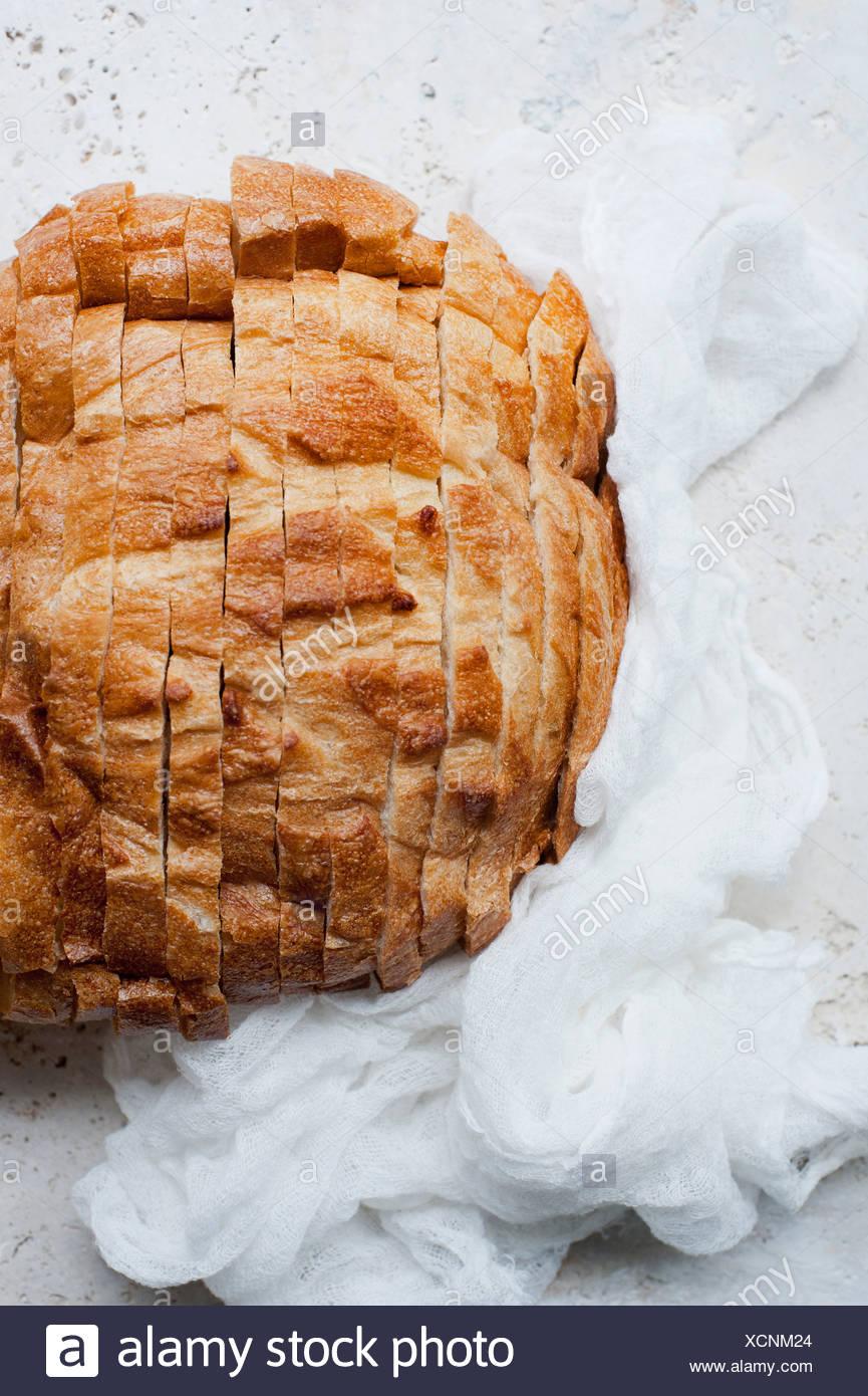 Still life of rustic sliced bread - Stock Image