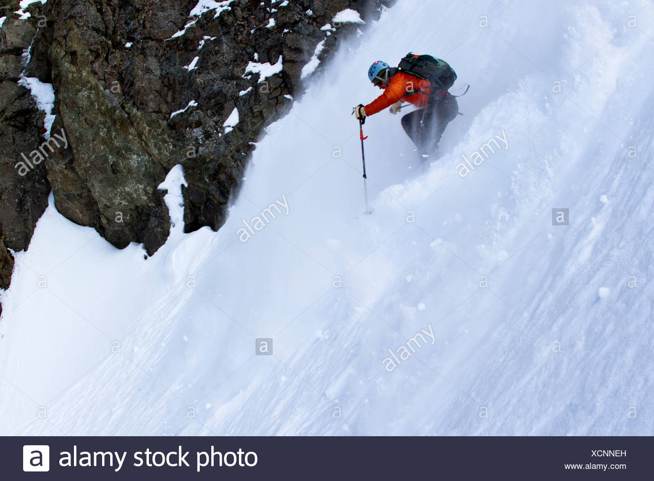 Man backcountry skiing on the north face of Korohusk Peak in the Ram Valley, Chugach Mountains, Eagle River, Southcentral Alaska - Stock Image