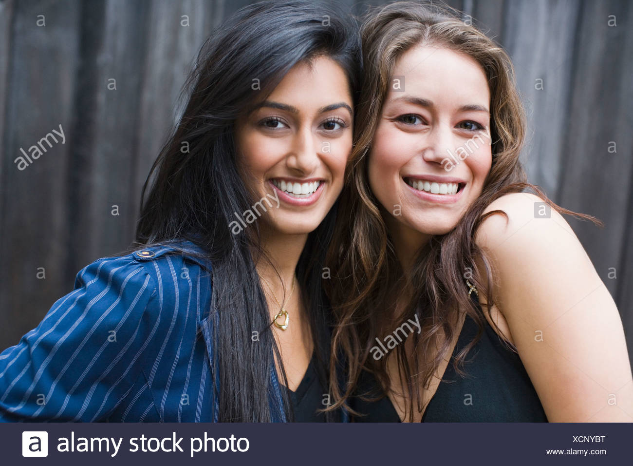 Portrait of two women smiling - Stock Image