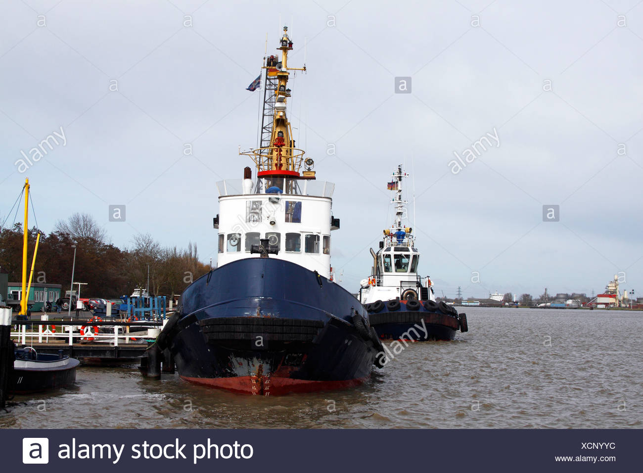 Ships, tug boats, pilot cutters on the Nord-Ostsee-Kanal, Kiel-Canal, Brunsbuettel, district Dithmarschen, Schleswig-Holstein,  - Stock Image