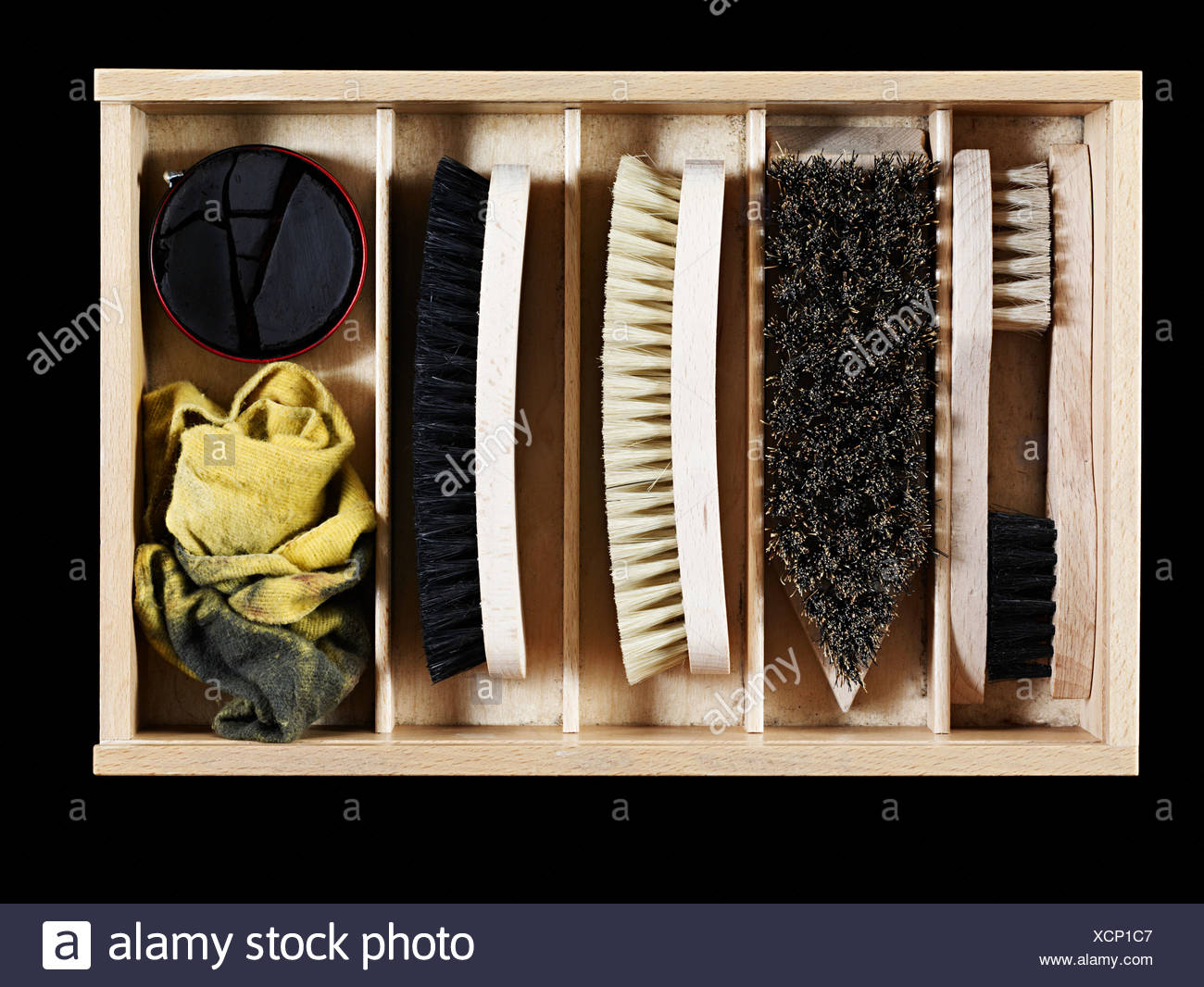Shoe polish and brushes in a box - Stock Image