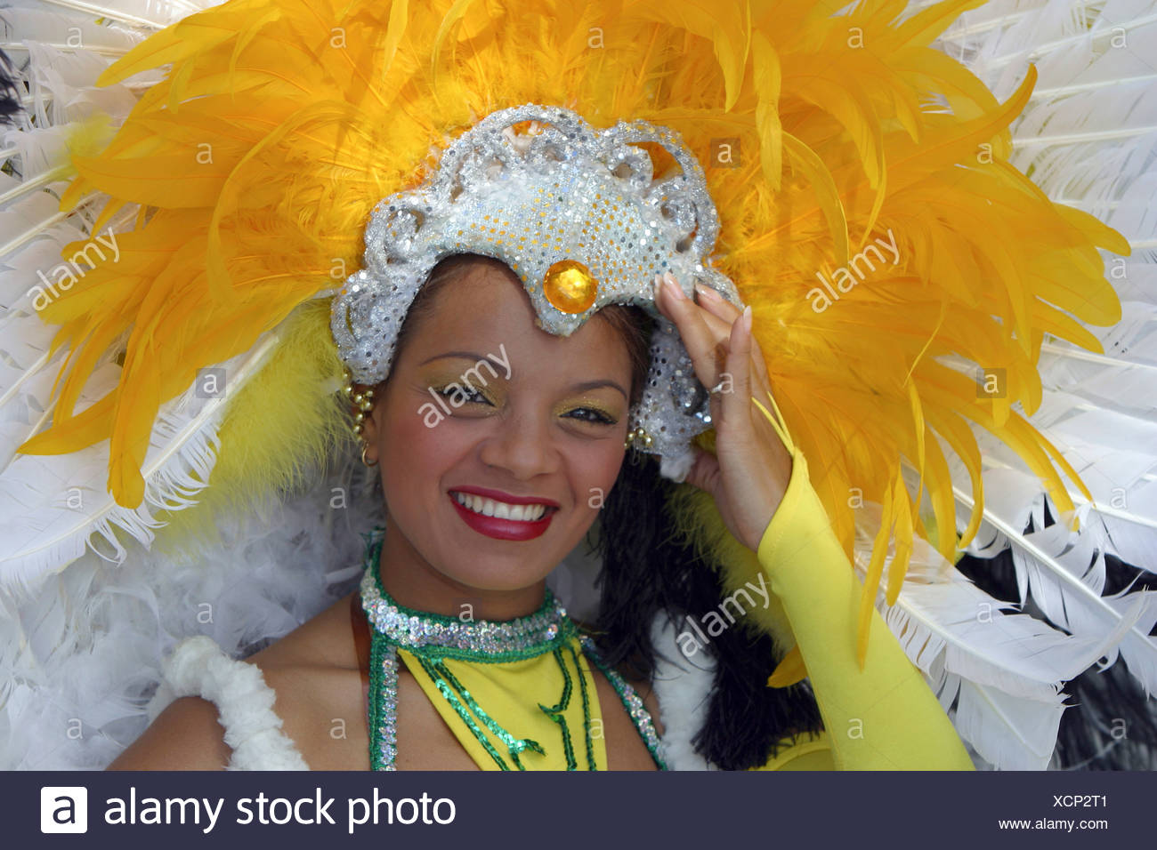 pretty woman with feathered headdress on national holiday, Dominican Republic, La Romana, Bayahibe - Stock Image