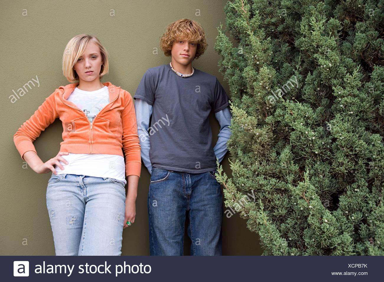Teenage couple stood outdoors - Stock Image