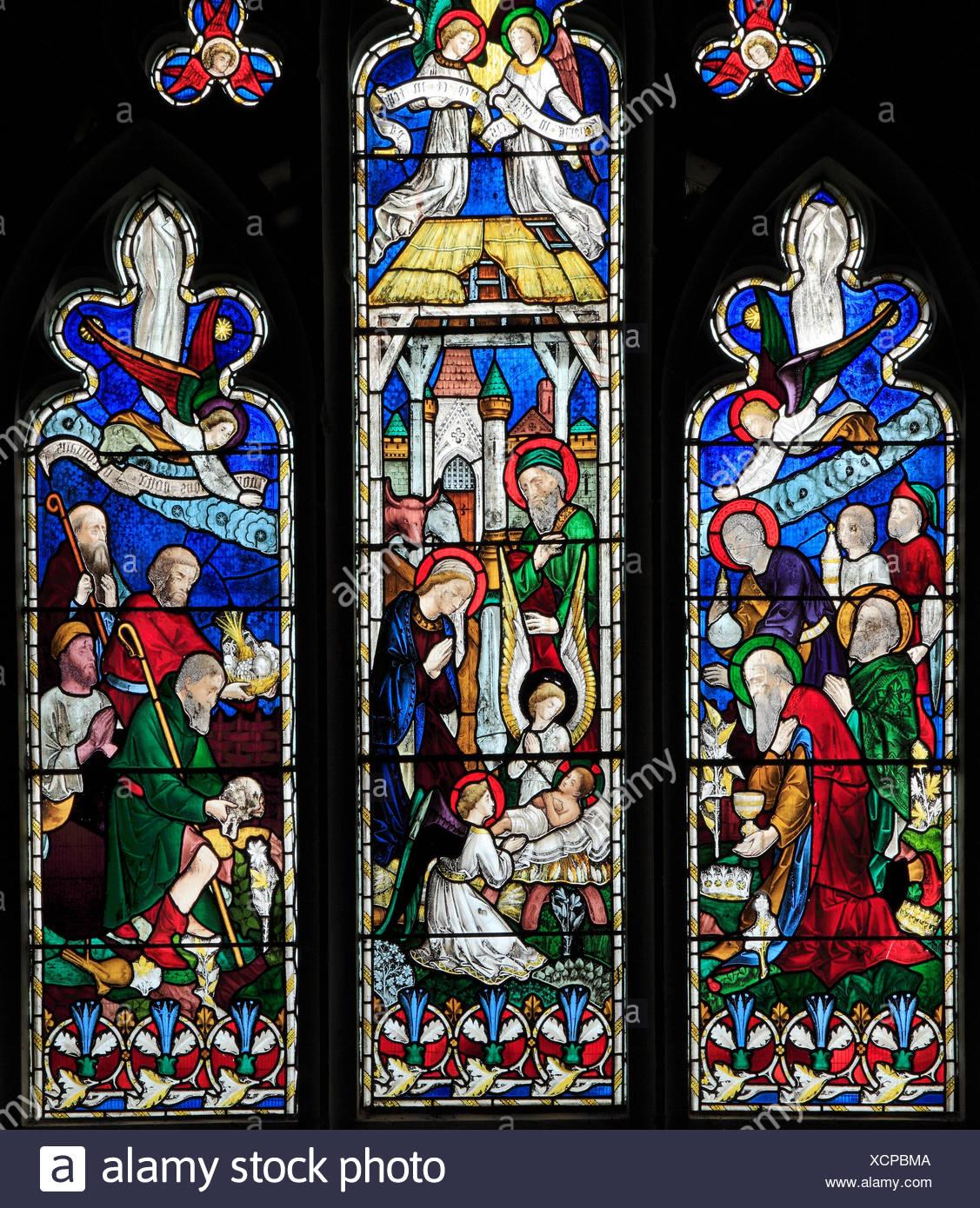 Nativity, stained glass window, by J. Hardman & Co, the Magi, Shepherds, infant baby Jesus, stable, Hillington, Norfolk, England, UK - Stock Image
