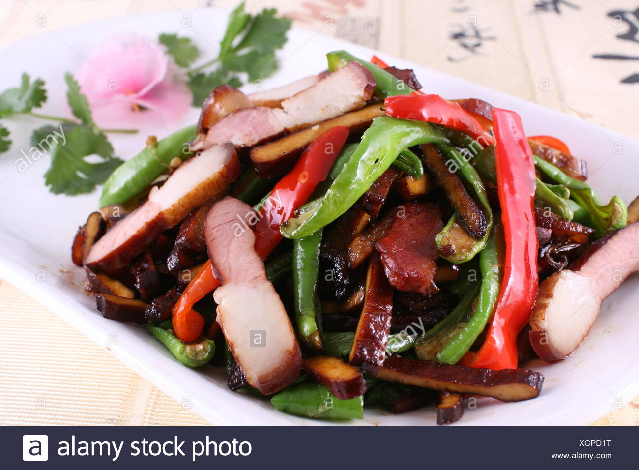 fried bacon and smoked tofu with green chilli - Stock Image