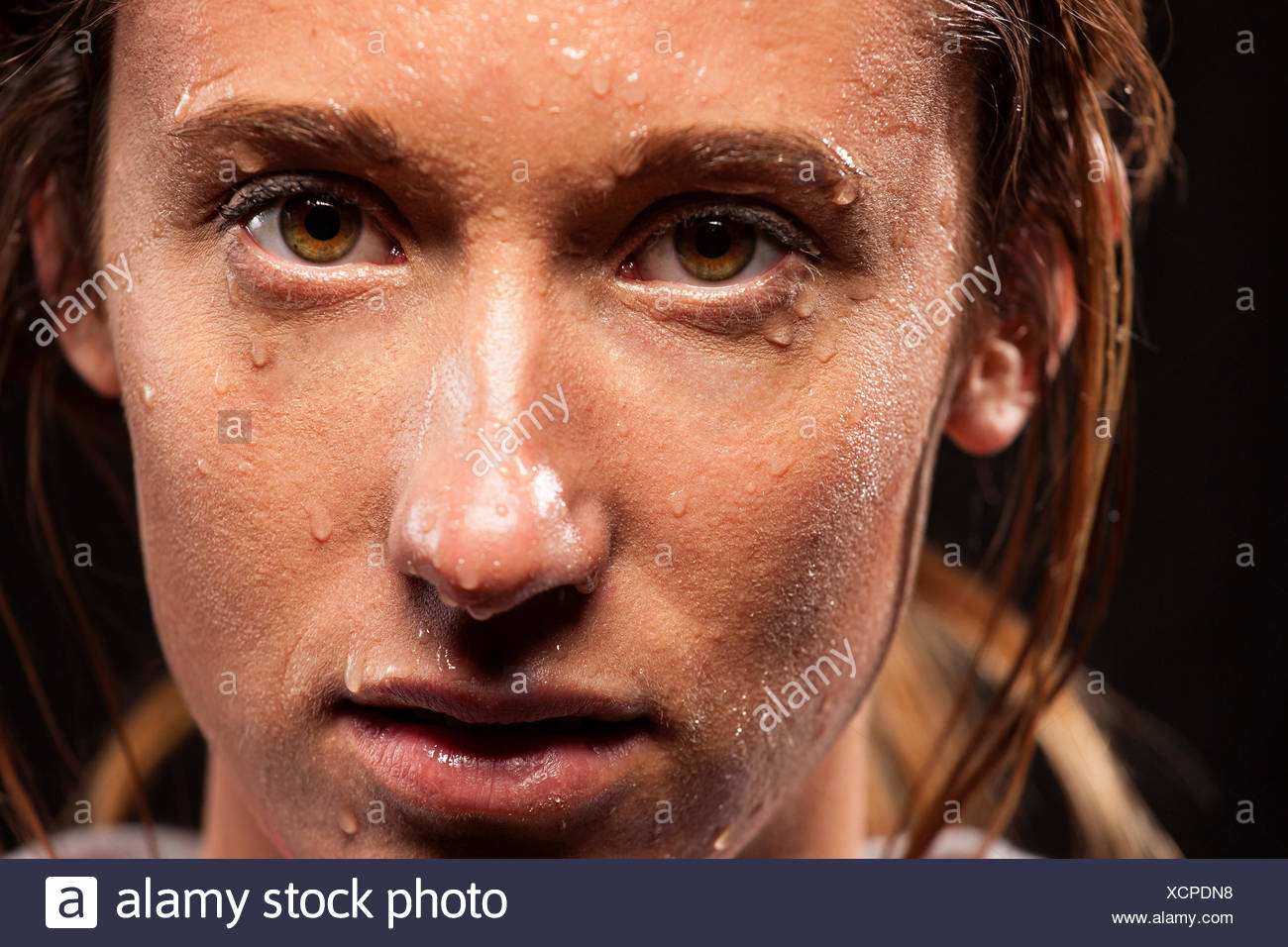 Woman with sweat on face - Stock Image