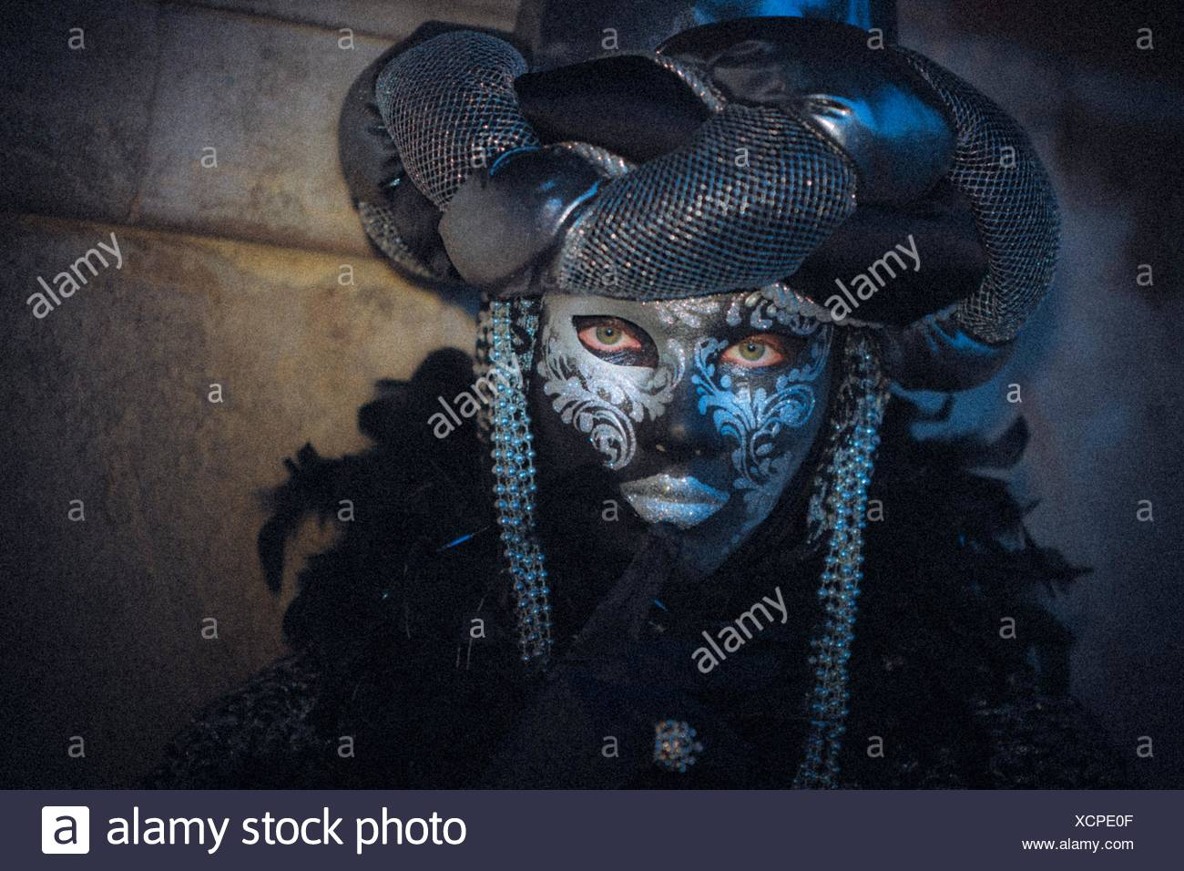 A mystical view of a masked person at the carnival in Venice, Italy, Europe - Stock Image