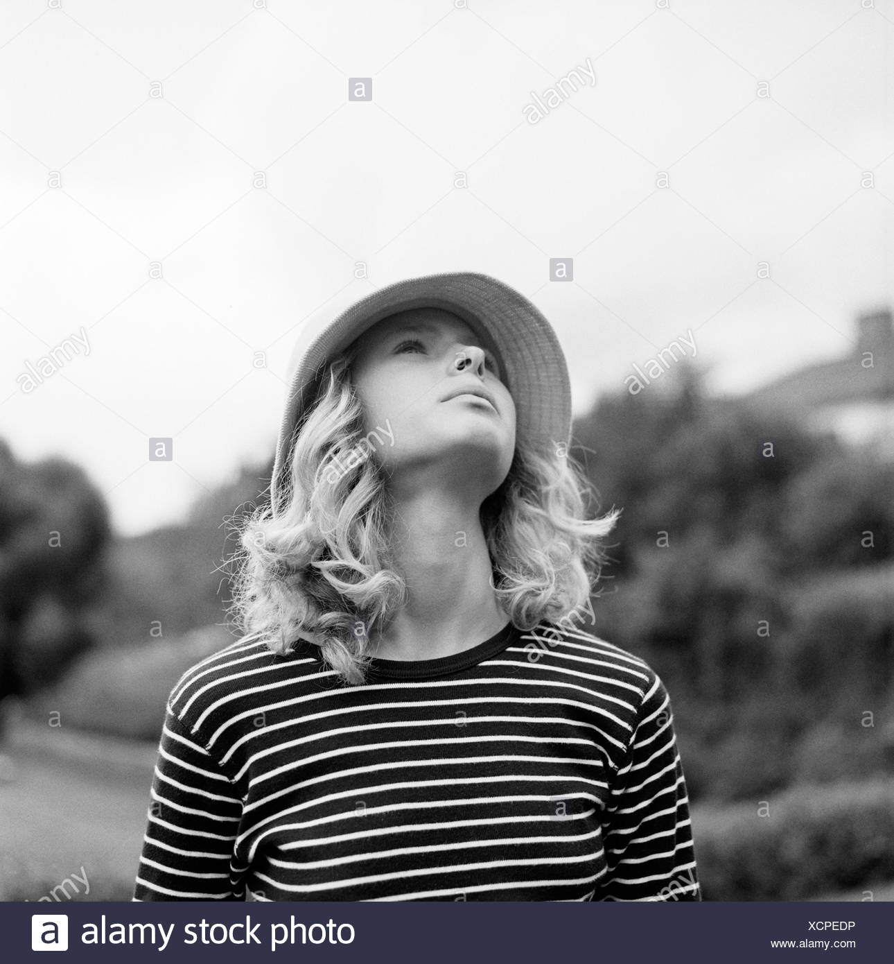 A Woman Looking Up In The Sky Stock Photo Alamy
