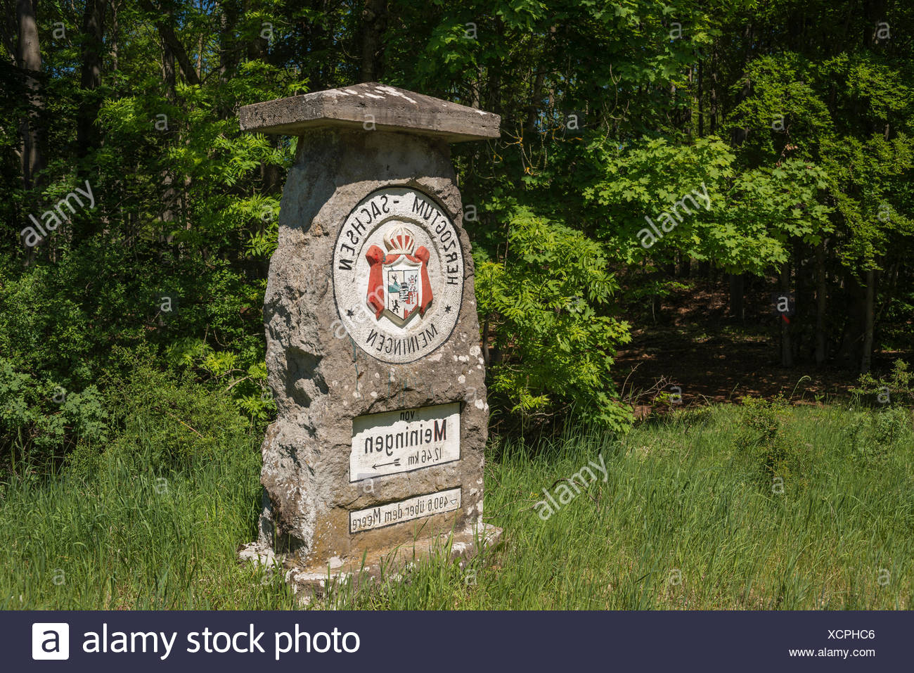 Historic boundary stone with crest of the Duchy of Saxe-Meiningen, now border of Thuringia and Bavaria, Henneberg, Thuringia - Stock Image