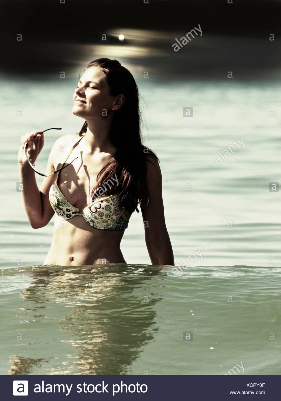 Bikini Woman In Sea - Stock Image