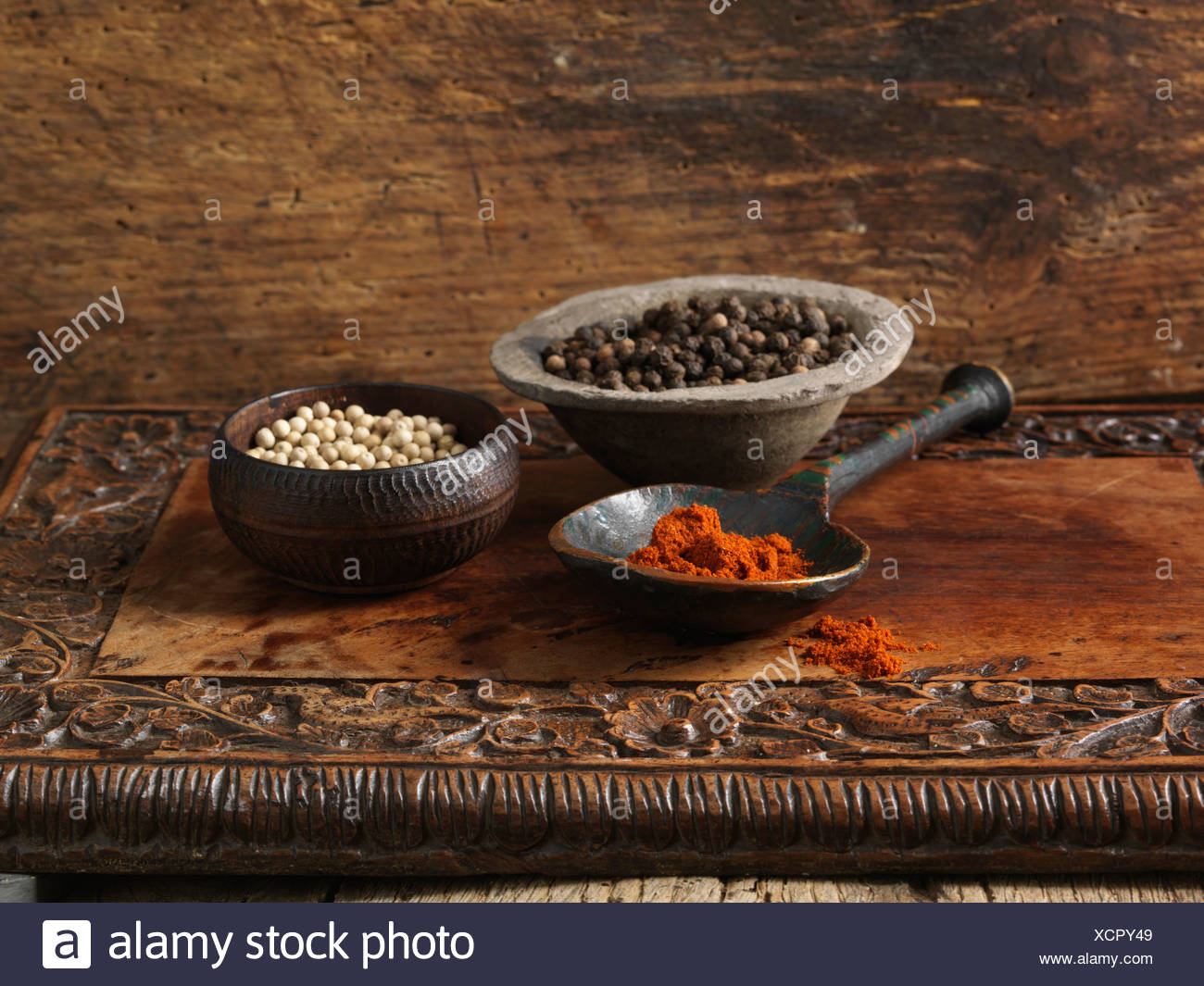 Black and white peppercorns and paprika - Stock Image