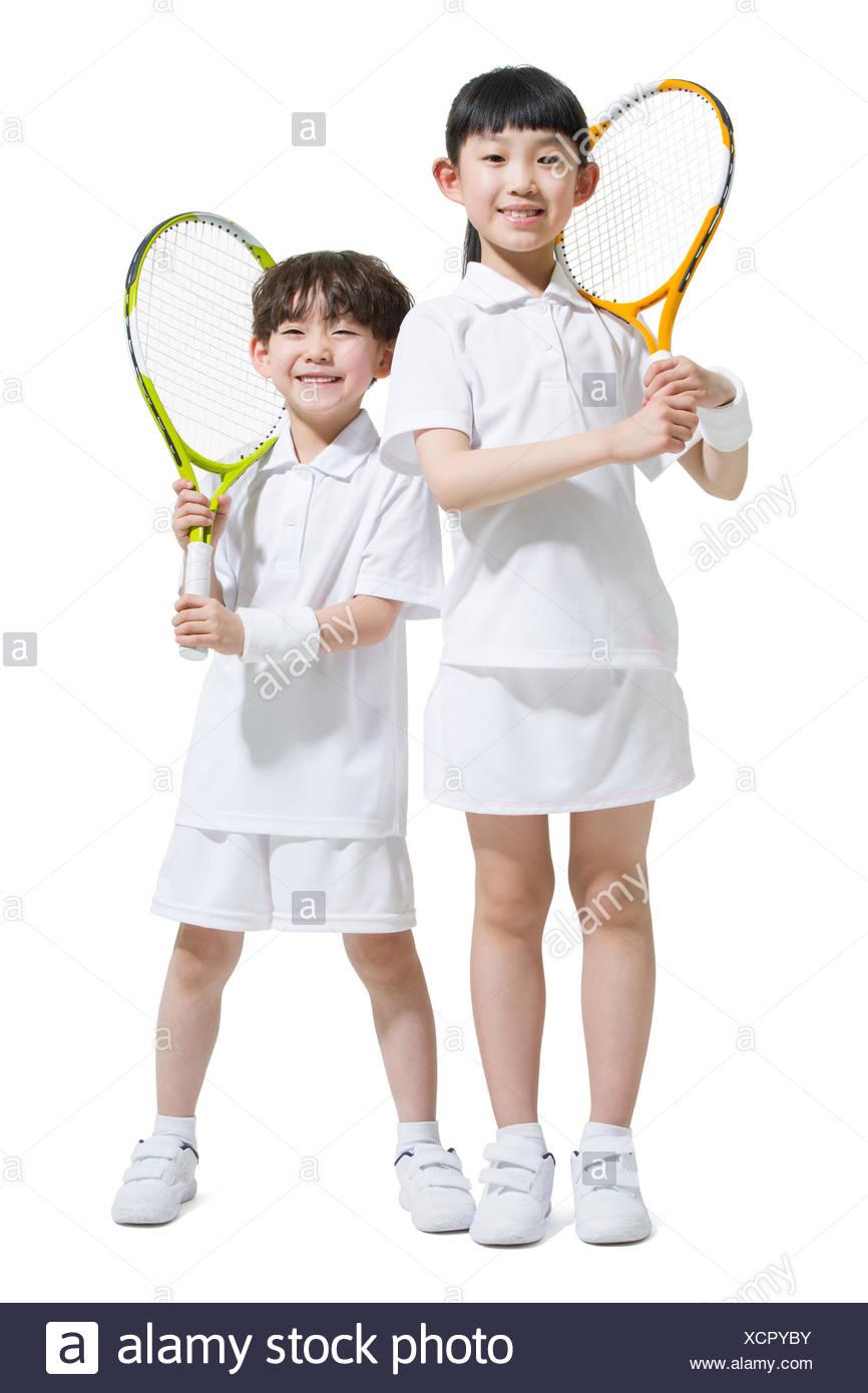 Cute children playing tennis - Stock Image