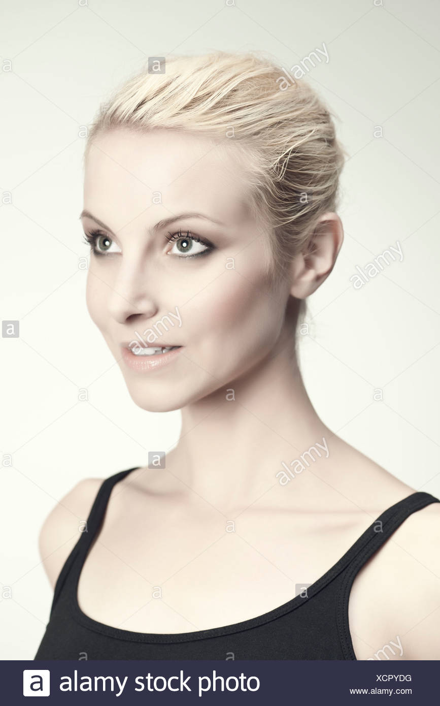 Young woman in thought, portrait - Stock Image