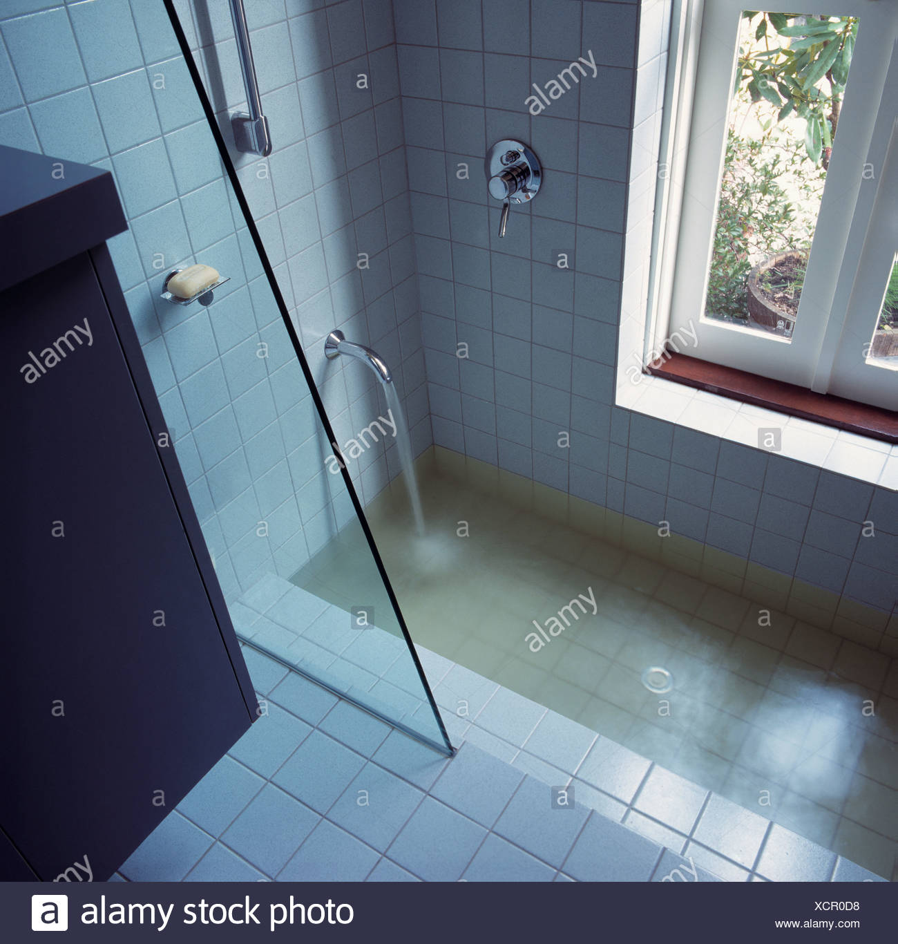 Bathroom shower and sunken bath Stock Photo: 283247028 - Alamy