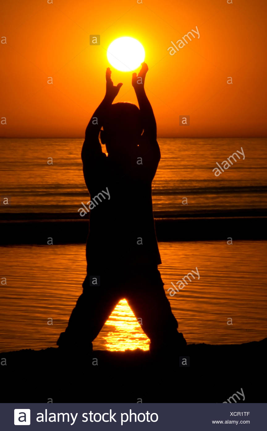Holding The Sun - Stock Image