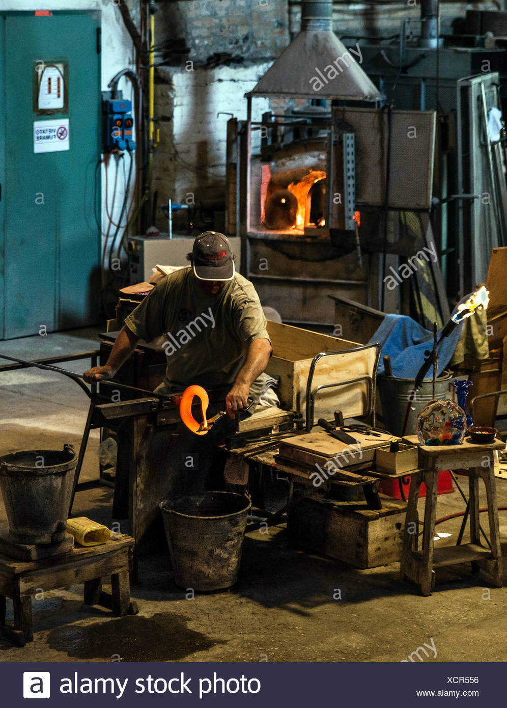 Glassmith working, Venitian island of Murano, Italy. Famous for it's many furnaces and hand made glass. - Stock Image
